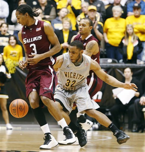 Wichita State's Tekele Cotton (32) steals the ball from Southern Illinois' Desmar Jackson (3) during the second half of their NCAA college basketball game, Wednesday, Jan. 9, 2013, in Wichita, Kan. (AP Photo/The Wichita Eagle, Fernando Salazar)