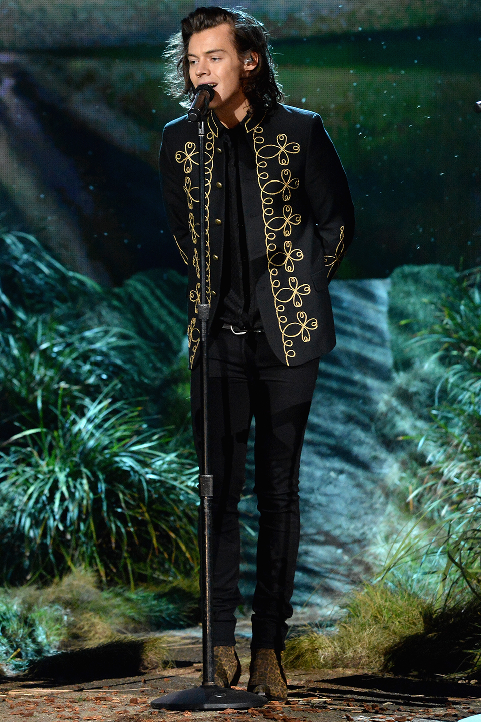 """<p>This isn't technically a suit — I think he's wearing jeans on the bottom — but it merits inclusion because look at this gorgeous jacket! Harry wore this while performing """"Night Changes"""" with the rest of 1D at the 2014 AMAs. Harry girls everywhere—me, duh—rejoiced.</p>"""
