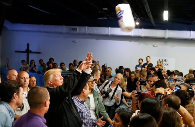 U.S. President Donald Trump throws rolls of paper towels into a crowd of local residents affected by Hurricane Maria as he visits Calgary Chapel in San Juan. (Jonathan Ernst / Reuters)
