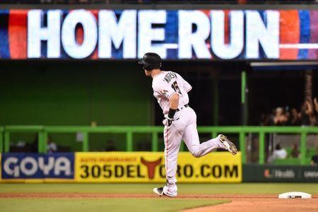 Jul 9, 2018; Miami, FL, USA; Miami Marlins right fielder Brian Anderson (15) rounds the bases after hitting a solo home run in the seventh inning against the Milwaukee Brewers at Marlins Park. Mandatory Credit: Jasen Vinlove-USA TODAY Sports