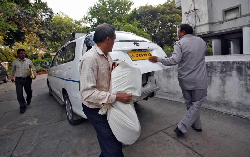 CBI officials carry a bag of documents after conducting a raid at a building as part of probes into the AgustaWestland bribery case in New Delhi