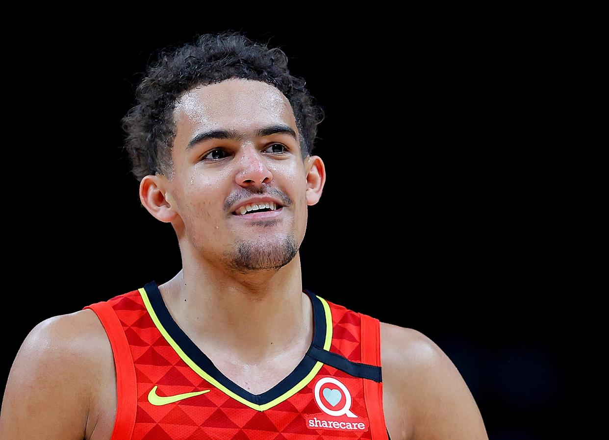 ATLANTA, GEORGIA - JANUARY 26:  Trae Young #11 of the Atlanta Hawks reacts after drawing a foul in the second half against the Washington Wizards at State Farm Arena on January 26, 2020 in Atlanta, Georgia.  NOTE TO USER: User expressly acknowledges and agrees that, by downloading and/or using this photograph, user is consenting to the terms and conditions of the Getty Images License Agreement.  (Photo by Kevin C. Cox/Getty Images)