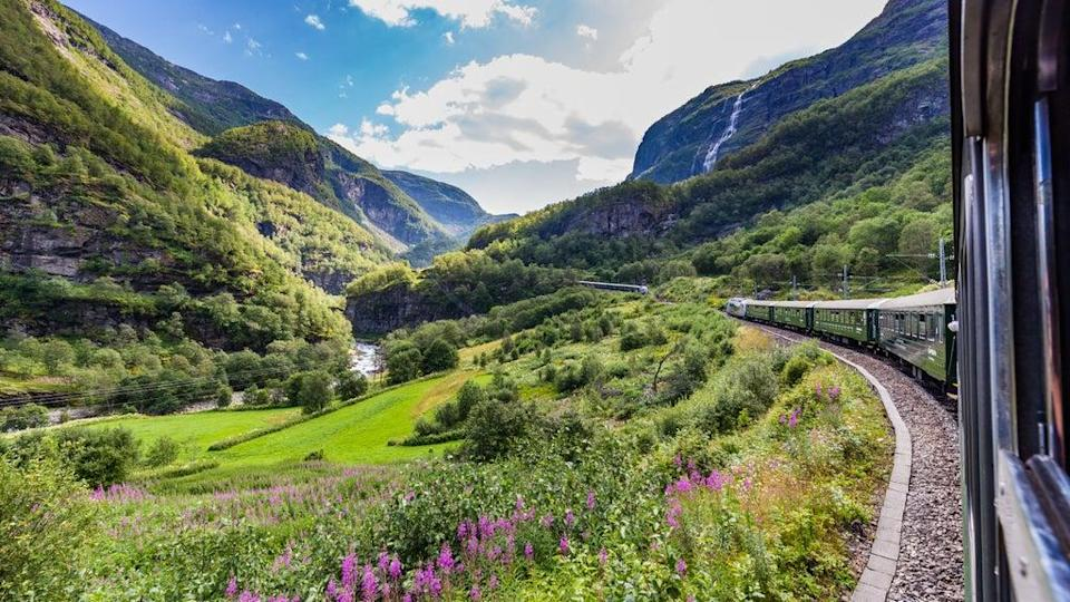 Travelling by train emits around 85 per cent less carbon than flying  (Getty/iStock)