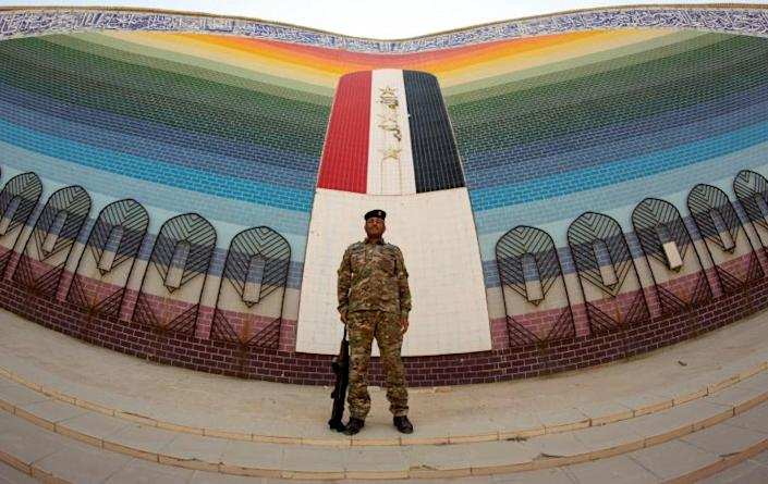 Four decades after the Iran-Iraq war began, Tehran has close allies in Baghdad's halls of power -- and in this photograph an Iraqi soldier stands guard at an Iraqi mosque built after the end of the conflict