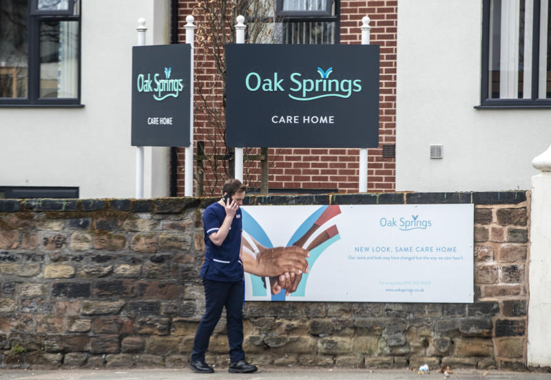 A member of staff outside The Oak Springs care home in Wavertree, Liverpool, which was operating with a quarter of its usual staff numbers due to Covid-19, according to Labour MP Paula Barker.