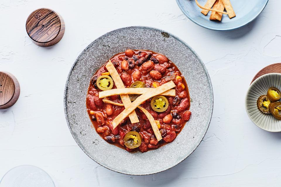 """Whether you're watching football or not, it's definitely chili season. This version gives you full flavor (thanks to a few pantry shortcuts) in just 30 minutes. <a href=""""https://www.epicurious.com/recipes/food/views/vegetarian-three-bean-chili?mbid=synd_yahoo_rss"""" rel=""""nofollow noopener"""" target=""""_blank"""" data-ylk=""""slk:See recipe."""" class=""""link rapid-noclick-resp"""">See recipe.</a>"""