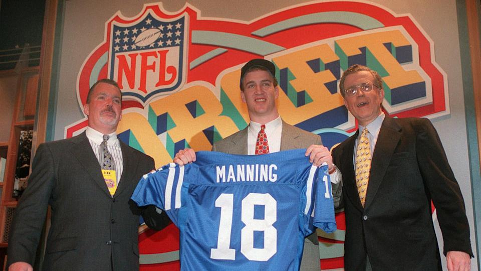 IRSAY TAGLIABUE Quarterback Peyton Manning, of Tennissee, holds holds up an Indianapolis Colts jersey as he is flanked by Colts owner Jim Irsay, left, and NFL Commissioner Paul Tagliabue, in New York after being chosen by the Colts as the No.