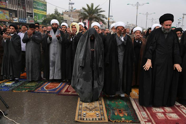 FILE - In this file photo taken Friday, Jan. 17, 2014, followers of Shiite cleric Muqtada al-Sadr crowd a street as they attend open air Friday prayers in the Shiite stronghold of Sadr City in Baghdad, Iraq. As parliamentary elections are held Wednesday, April 30, more than two years after the withdrawal of U.S. troops, Baghdad is once again a city gripped by fear and scarred by violence. (AP Photo/Karim Kadim, File)