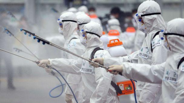 PHOTO: Soldiers wearing protective gear spray disinfectant as part of preventive measures against the spread of the coronavirus, at Dongdaegu railway station in Daegu, South Korea, Feb. 29, 2020. (Yonhap/AFP/Getty Images)