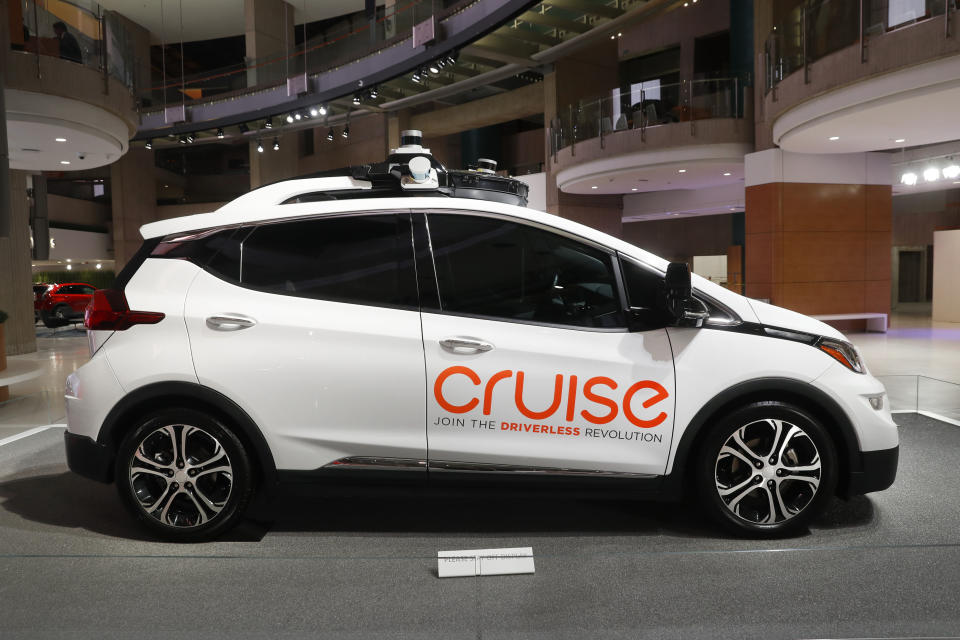 FILE - In this Jan. 16, 2019, file photo, Cruise AV, General Motor's autonomous electric Bolt EV is displayed in Detroit. General Motors' Cruise autonomous vehicle unit says it will pull the human backup drivers from its vehicles in San Francisco by the end of the year. CEO Dan Ammann says that the Cruise got a permit from California's Department of Motor Vehicles on Thursday, Oct. 15, 2020 to let the cars travel on their own.  (AP Photo/Paul Sancya, File)