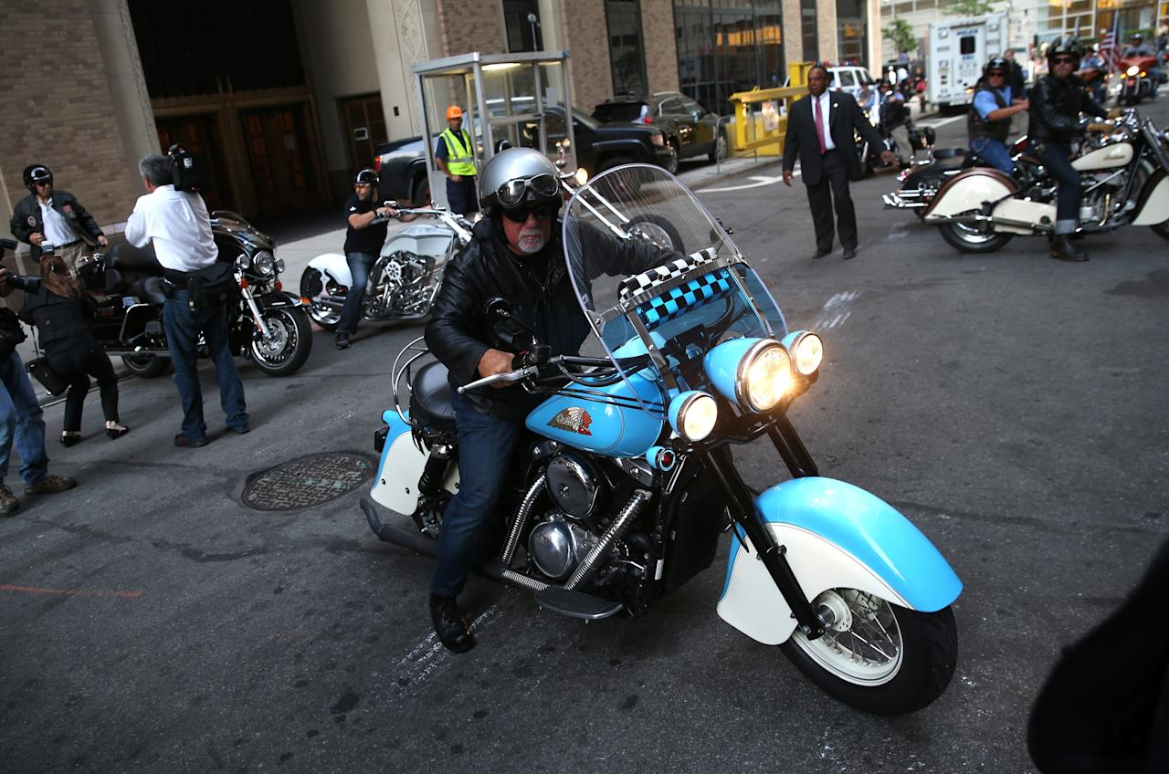 NEW YORK, NY - SEPTEMBER 11: Singer and New Yorker Billy Joel (C), rides with members of the Fire Department of New York (FDNY), motorcycle club on September 11, 2013 in New York City. The nation is commemorating the anniversary of the 2001 attacks which resulted in the deaths of nearly 3,000 people after two hijacked planes crashed into the World Trade Center, one into the Pentagon in Arlington, Virginia and one crash landed in Shanksville, Pennsylvania. Following the attacks in New York, the former location of the Twin Towers has been turned into the National September 11 Memorial & Museum. (Photo by John Moore/Getty Images)