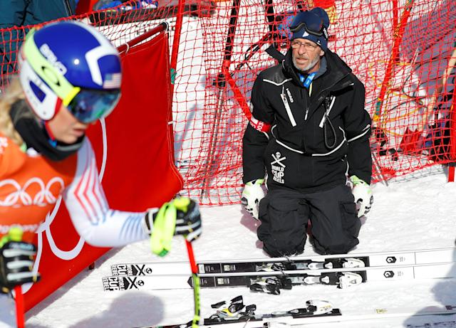 """Heinz Haemmerle, or """"Magic Heinzi"""" as US skier Lindsey Vonn calls her Austrian-born ski technician, looks at the world's most successful skiing woman before the start of Vonn's third Olympic Downhill training run at the Winter Olympics 2018 in Pyeongchang, South Korea February 20, 2018. REUTERS/Leonhard Foeger"""