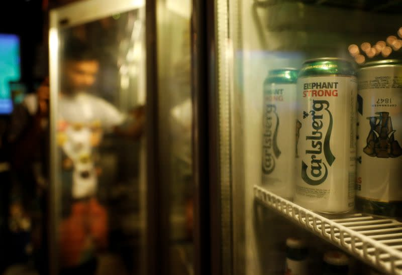 Carlsberg beer cans are seen at a pub in Mumbai