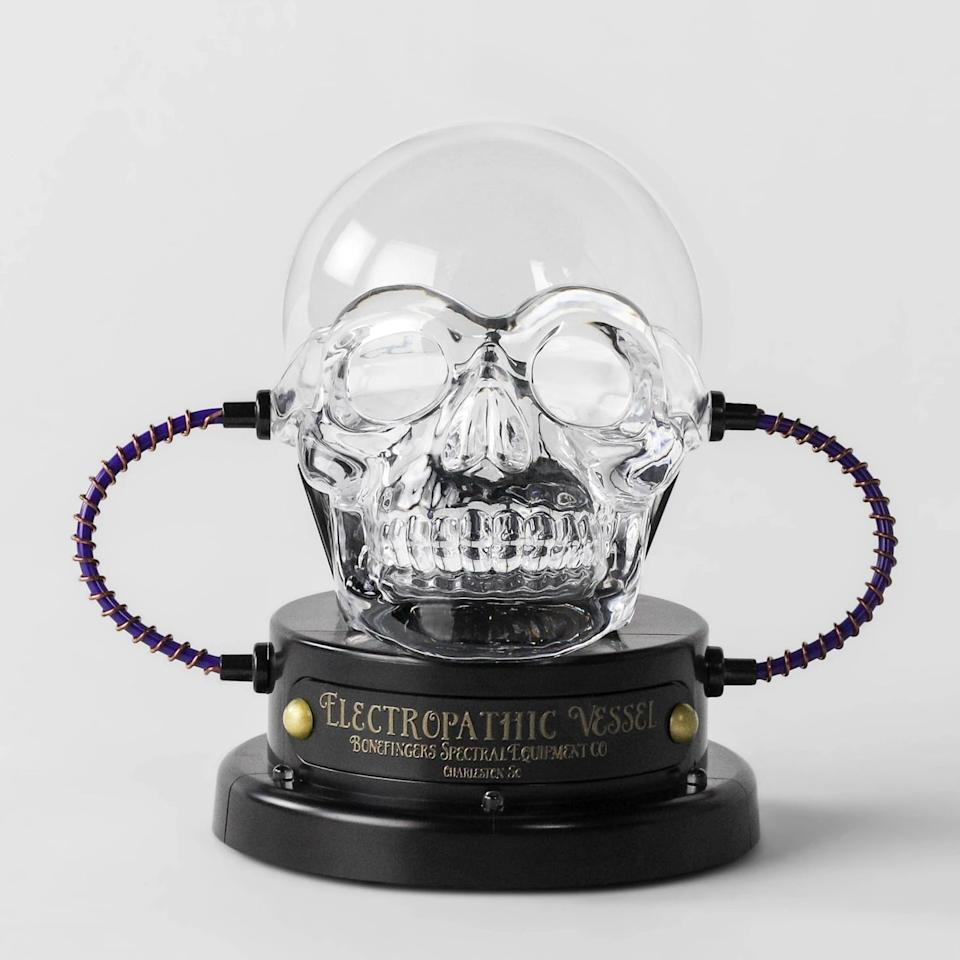 """<p>This <a href=""""https://www.popsugar.com/buy/Animated-LED-Skull-Plasma-Ball-481473?p_name=Animated%20LED%20Skull%20Plasma%20Ball&retailer=target.com&pid=481473&price=15&evar1=moms%3Aus&evar9=46513190&evar98=https%3A%2F%2Fwww.popsugar.com%2Fphoto-gallery%2F46513190%2Fimage%2F46513435%2FAnimated-LED-Skull-Plasma-Ball&list1=shopping%2Ctarget%2Challoween%2Challoween%20decor%2Cdecor%20shopping&prop13=api&pdata=1"""" rel=""""nofollow"""" data-shoppable-link=""""1"""" target=""""_blank"""" class=""""ga-track"""" data-ga-category=""""Related"""" data-ga-label=""""https://www.target.com/p/animated-led-skull-plasma-ball-decorative-halloween-prop-hyde-38-eek-boutique-hyde-and-eek-boutique-8482/-/A-54406967"""" data-ga-action=""""In-Line Links"""">Animated LED Skull Plasma Ball</a> ($15) will literally make your <a class=""""sugar-inline-link ga-track"""" title=""""Latest photos and news for halloween"""" href=""""https://www.popsugar.com/Halloween"""" target=""""_blank"""" data-ga-category=""""Related"""" data-ga-label=""""https://www.popsugar.com/Halloween"""" data-ga-action=""""&lt;-related-&gt; Links"""">Halloween</a> party <em>lit</em>.</p>"""