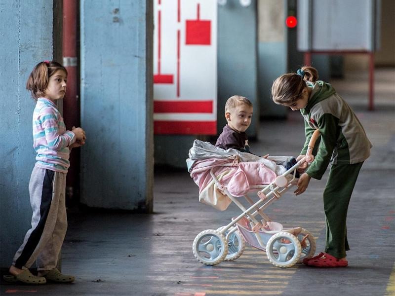 Children play in a building converted into refugee accommodation in Frankfurt (EPA)