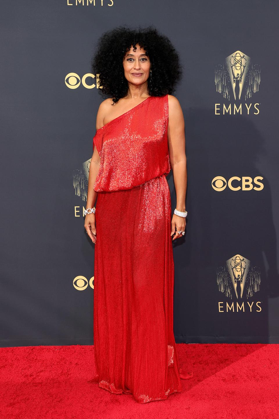 Tracee looked cool as ever in a one-shouldered red beaded Valentino column gown.