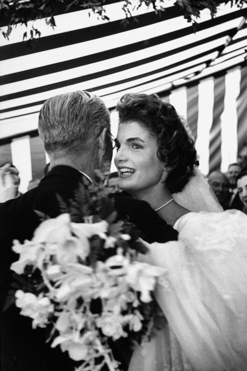Former US Amb. to Great Britain Joseph Kennedy, dancing with son John F. Kennedy's bride, Jacqueline Bouvier Kennedy, at their wedding reception held at her mother's home. (Photo by Lisa Larsen//Time Life Pictures/Getty Images)