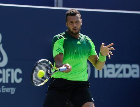 Jo Wilfried Tsonga (FRA) plays a forehand against Roger Federer (not pictured) in the mens final on day seven of the Rogers Cup tennis tournament at Rexall Centre - Tsonga won 7-5 7-6. Peter Llewellyn-USA TODAY Sports