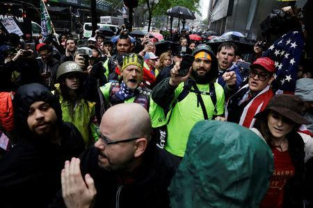 People protesting against CUNY's decision to allow Linda Sarsour, a liberal, Palestinian-American political activist, to speak at this year's commencement argue with anti-Trump demonstrators in New York, U.S., May 25, 2017. REUTERS/Lucas Jackson
