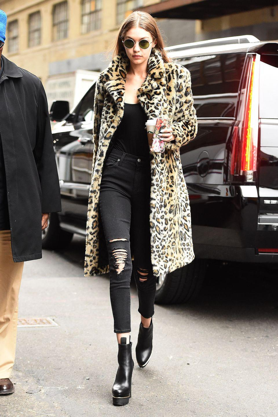 <p>In a leopard coat, black top, Ksubi black distressed jeans, Versace platform ankle boots and rounded sunglasses while out in New York.</p>