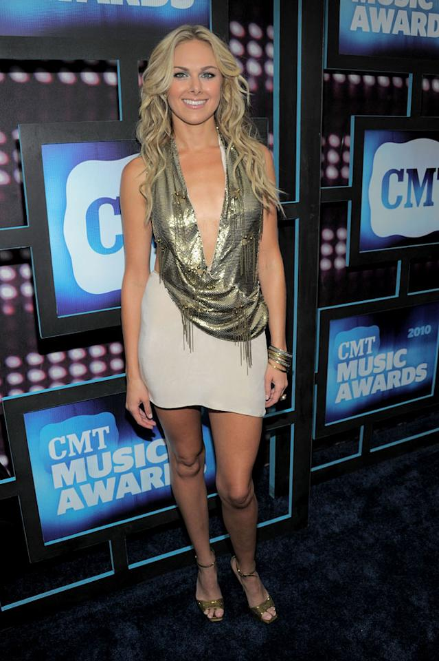 """""""Giddy On Up"""" songstress Laura Bell Bundy left little to the imagination in a revealing gold top, nude miniskirt, and strappy metallic heels. Kevin Mazur/<a href=""""http://www.wireimage.com"""" target=""""new"""">WireImage.com</a> - June 9, 2010"""