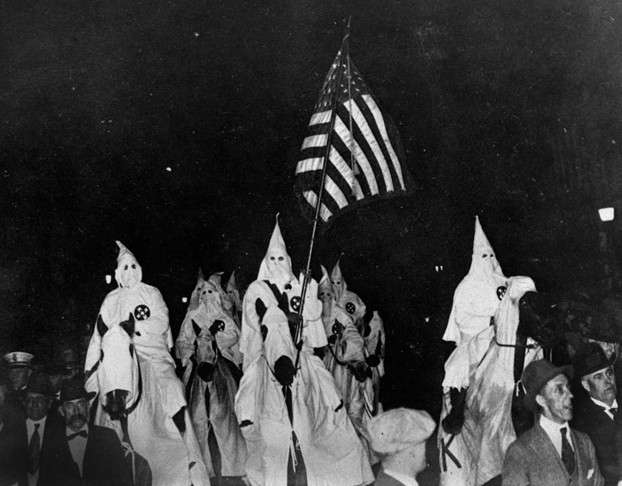 <p>Members of the Ku Klux Klan ride horses during a parade through the streets of Tulsa, Okla., Sept. 21, 1923. (Photo: AP) </p>