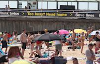People on Bournemouth beach as the Met Office says it expects Friday to be the hottest day of the year so far with temperatures even nudging into 35C (95F) in Greater London.