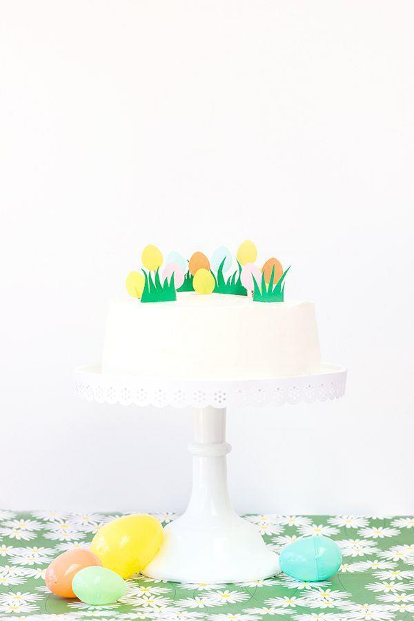 """<p>Take a plain white <a href=""""https://www.goodhousekeeping.com/holidays/easter-ideas/g4156/easter-cakes/"""" rel=""""nofollow noopener"""" target=""""_blank"""" data-ylk=""""slk:Easter cake"""" class=""""link rapid-noclick-resp"""">Easter cake</a> from basic to beautiful with these simple cake toppers made with cardstock and paper punches.</p><p><em><a href=""""http://studiodiy.com/2014/03/27/diy-easter-egg-hunt-cake/"""" rel=""""nofollow noopener"""" target=""""_blank"""" data-ylk=""""slk:Get the tutorial at Studio DIY »"""" class=""""link rapid-noclick-resp"""">Get the tutorial at Studio DIY »</a></em></p><p><a class=""""link rapid-noclick-resp"""" href=""""https://www.amazon.com/Punch-Bunch-Large-Egg/dp/B018E6S8FU/?tag=syn-yahoo-20&ascsubtag=%5Bartid%7C10055.g.2217%5Bsrc%7Cyahoo-us"""" rel=""""nofollow noopener"""" target=""""_blank"""" data-ylk=""""slk:BUY EGG PUNCH"""">BUY EGG PUNCH</a> <br></p>"""