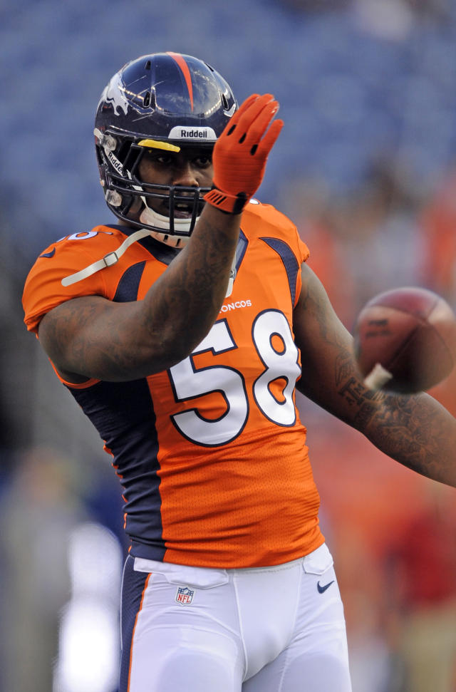 Denver Broncos outside linebacker Von Miller warms up before the start of a pre-season NFL football game against the Arizona Cardinals on Thursday, Aug. 29, 2013, in Denver. (AP Photo/Jack Dempsey)