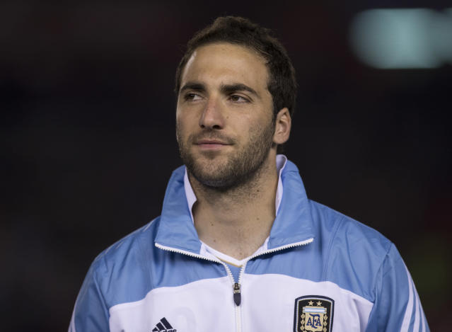 Argentina's Gonzalo Higuain stands during the playing of his country's national anthem before the start of a 2014 World Cup qualifying soccer match against Colombia in Buenos Aires, Argentina, Friday, June 7, 2013. (AP Photo/Eduardo Di Baia)
