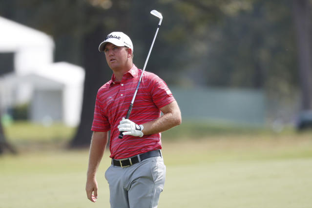 Tom Hoge watches his approach shot on the 18th fairway during the opening round of the Sanderson Farms Championship golf tournament in Jackson, Miss., Thursday, Sept. 19, 2019. (AP Photo/Rogelio V. Solis)