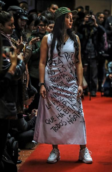 Models showed off the first fashion collection designed in one of the country's 26 rebel reintegration zones (AFP Photo/Juan BARRETO)