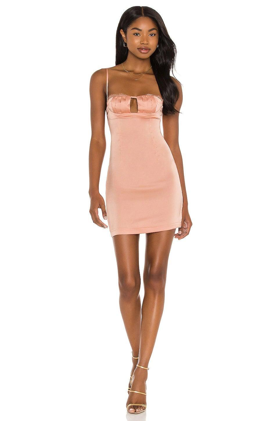 <p>You'll look absolutely fabulous in this <span>superdown Luna Lace Mini Dress in Blush</span> ($43, originally $66), whether your out with friends or having a date night. This mini dress is a total vibe for the season.</p>