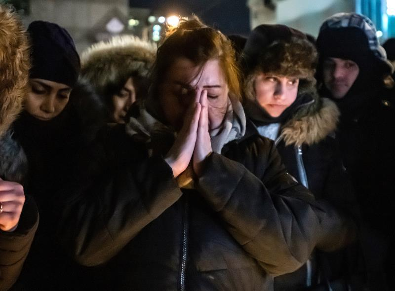 People attend a vigil for those killed when Ukraine International Airlines Flight PS752 crashed in Iran on 08 January 2020; in Toronto, Canada, 09 January 2020. EFE/EPA/WARREN TODA