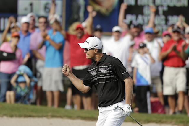 John Senden, of Australia, celebrates after chipping in on the 16th hole during the final round of the Valspar Championship golf tournament at Innisbrook, Sunday, March 16, 2014, in Palm Harbor, Fla. Senden won the tournament. (AP Photo/Chris O'Meara)