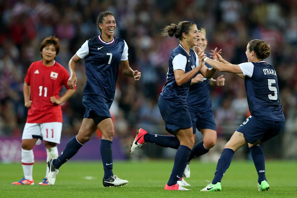 LONDON, ENGLAND - AUGUST 09: Carli Lloyd #10 of United States celebrates with Kelley O'Hara #5 and Shannon Boxx #7 after scoring in the second half against Japan during the Women's Football gold medal match on Day 13 of the London 2012 Olympic Games at Wembley Stadium on August 9, 2012 in London, England. (Photo by Julian Finney/Getty Images)