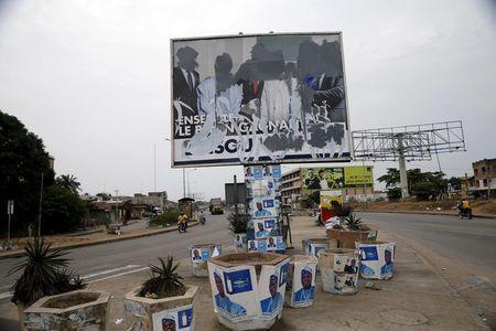 A defaced billboard is seen along a road, a day before Benin's presidential election in Cotonou, March 5, 2016. REUTERS/Akintunde Akinleye