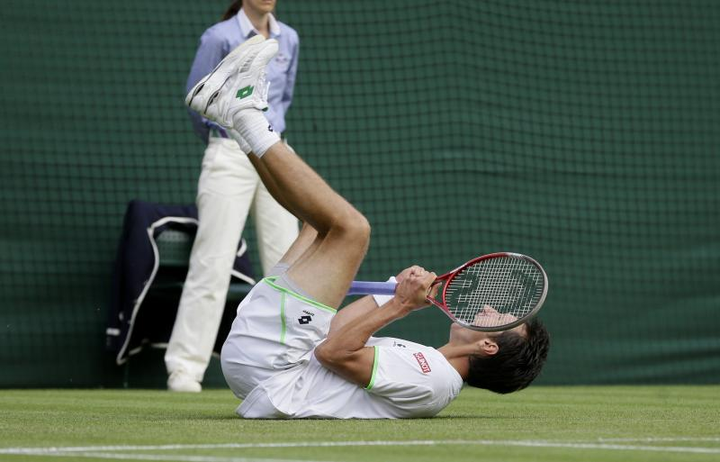 Sergiy Stakhovsky of Ukraine reacts as he wins against Roger Federer of Switzerland in their Men's second round singles match at the All England Lawn Tennis Championships in Wimbledon, London, Wednesday, June 26, 2013. (AP Photo/Alastair Grant)