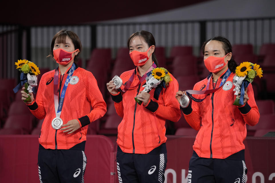 From left, silver medalists Miu Hirano, Kasumi Ishikawa, and Mima Ito of Japan pose with their medals during the medal ceremony for women's team table tennis at the 2020 Summer Olympics, Thursday, Aug. 5, 2021, in Tokyo. (AP Photo/Kin Cheung)