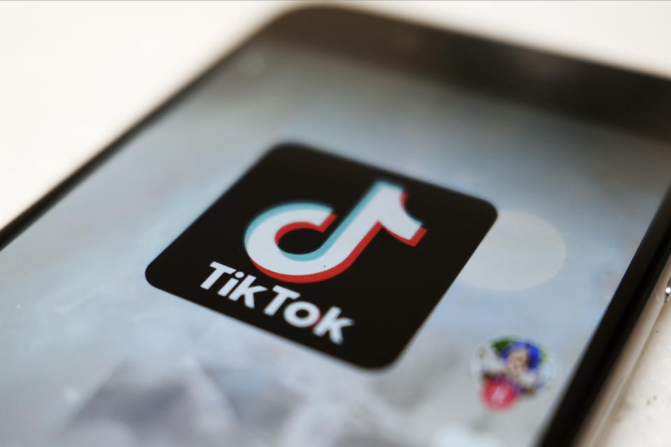 """FILE - This Monday, Sept. 28, 2020, file photo, shows as  logo of a smartphone app TikTok on a user post on a smartphone screen in Tokyo. Canadian e-commerce platform Shopify said Tuesday, Oct. 27, 2020, it's made a deal with TikTok enabling merchants to create """"shoppable"""" video ads that drive customers to online stores. (AP Photo/Kiichiro Sato, File)"""
