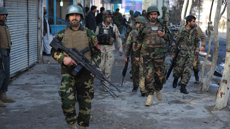 Afghan forces battle gunmen after blast