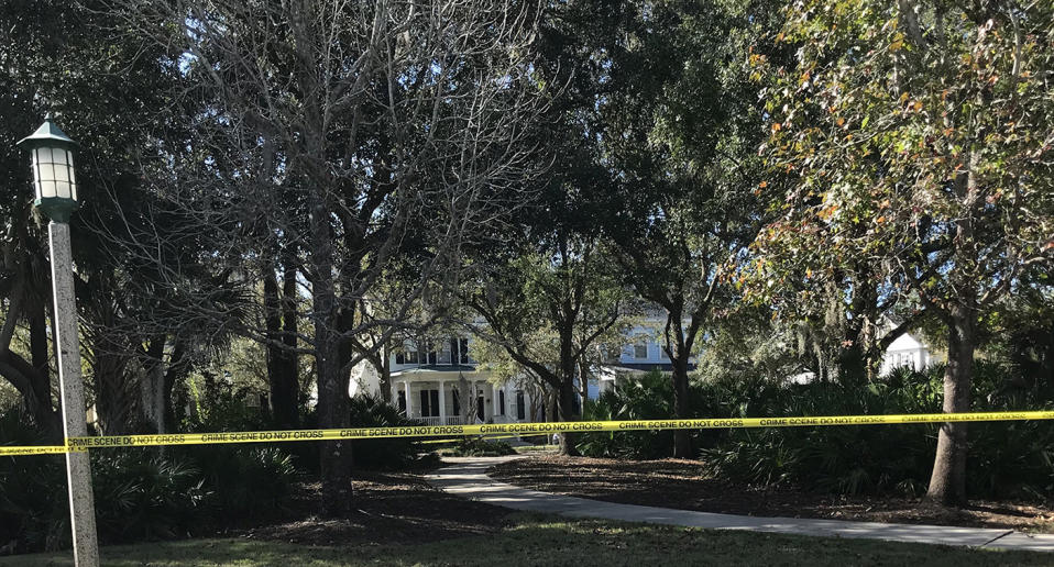 The white, two-story house where Anthony and Megan Todt lived with their three children remained a crime scene Tuesday, Jan. 14, 2020, the day after four bodies were found inside. Authorities have not publicly identified the deceased. (Grace Toohey/Orlando Sentinel/Tribune News Service via Getty Images)