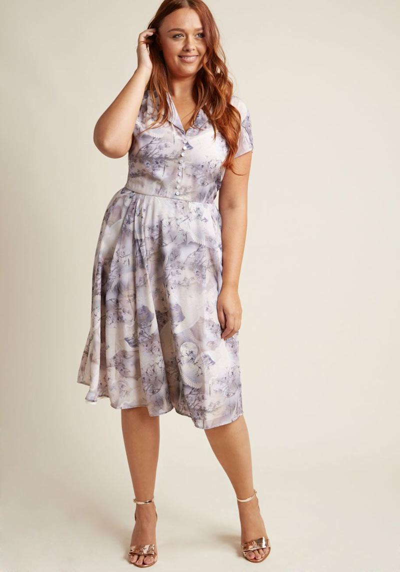 "If you're going to an outdoor fall wedding, then this ivory and amethyst masterpiece is the dress for you. Get it at <a href=""https://www.modcloth.com/shop/cocktail-dresses/hell-bunny-sculpture-garden-gala-midi-dress-in-mauve/153221.html?dwvar_153221_color=IVRY&breadcrumb=special_occasion_dresses_437"" target=""_blank"">Modcloth for $90</a>."