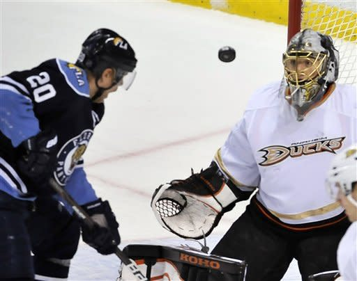 Anaheim Ducks goalie Jonas Hiller, right, makes a save on goal from Florida Panthers' Sean Bergenhim (20) during the second period of an NHL hockey game on Sunday, Feb. 19, 2012, in Sunrise, Fla. (AP Photo/Gary I Rothstein)