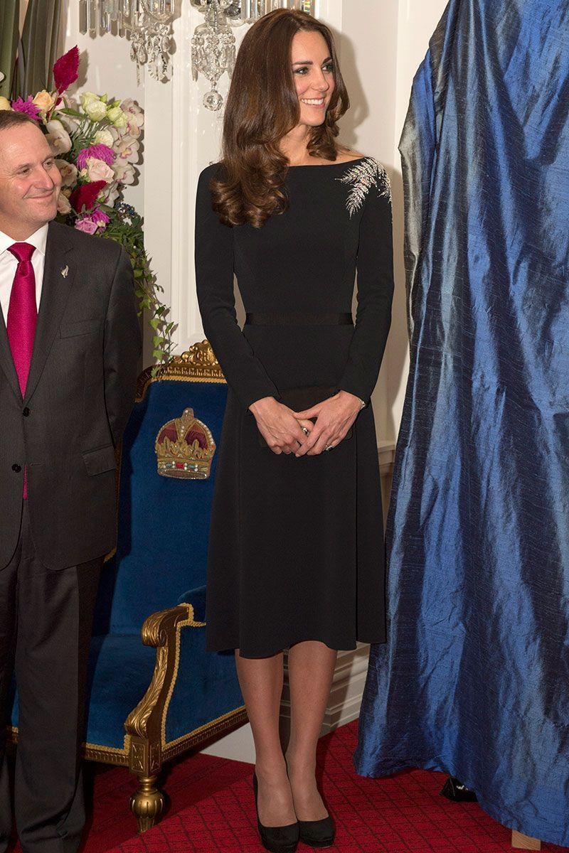 <p>Regal as ever, the Duchess of Cambridge added a bit of glamour to her long-sleeved black dress with a crystal embellishment on her shoulder. </p>