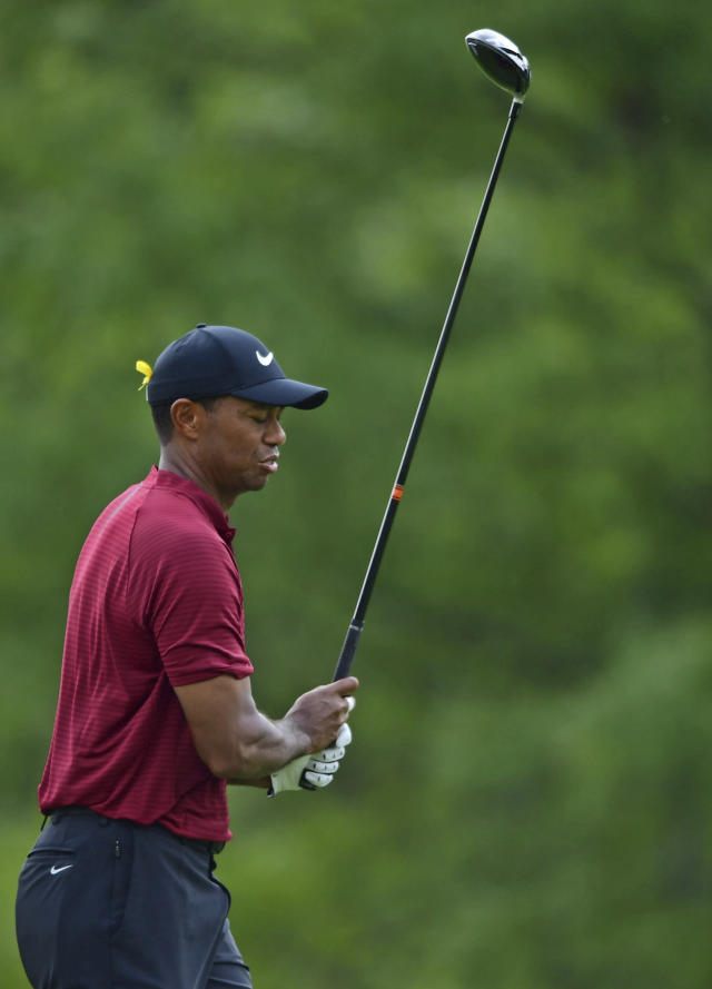 Tiger Woods reacts after his tee shot on the sixth hole during the final round of the Bridgestone Invitational golf tournament at Firestone Country Club, Sunday, Aug. 5, 2018, in Akron, Ohio. (AP Photo/David Dermer)