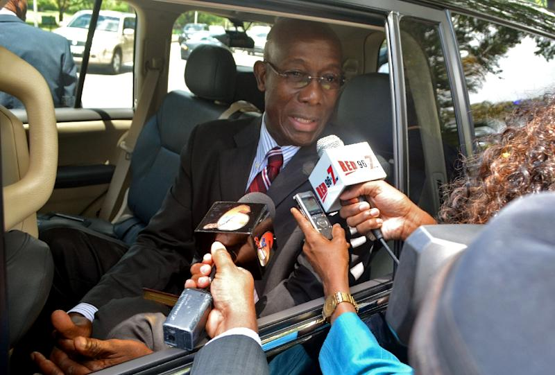 Trinidad and Tobago's Prime Minister-elect Keith Rowley speaks to reporters outside the presidential palace in Port-of-Spain on September 8, 2015