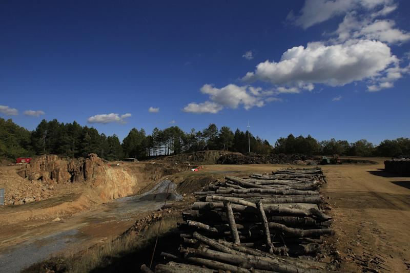 In this Thursday, Oct. 11, 2012, file photo, the trunks of cleared trees are seen in a gold mine complex in Skouries, in the Halkidiki peninsula in northern Greece. Mining company Hellas Gold expects the mine to be up and running by mid 2015 creating about 2000 jobs for the next five years. But while some see the gold mine seen as a savior _ as Greece enters a sixth year of recession amid record-high unemployment _ others revile it as an environmental catastrophe that will do little to help the economy. (AP Photo/Nikolas Giakoumidis)