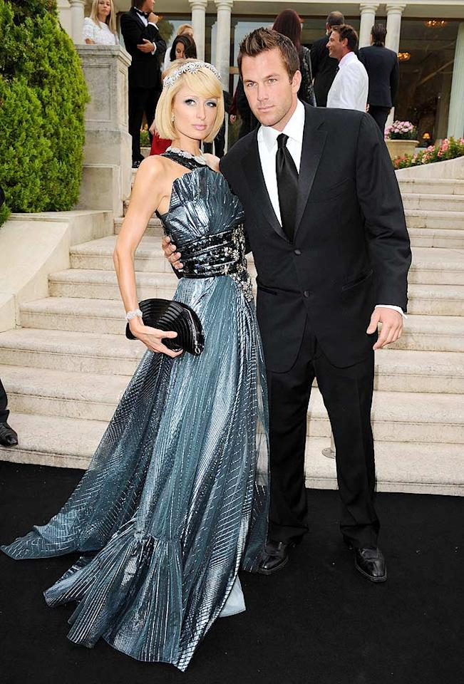 """Paris Hilton and Doug Reinhardt made a grand entrance at the amfAR Cinema Against Aids benefit in Cannes, France. As usual, the hotel heiress topped off her embellished Basil Soda gown with a headband. Pascal Le Segretain/<a href=""""http://www.gettyimages.com/"""" target=""""new"""">GettyImages.com</a> - May 21, 2009"""