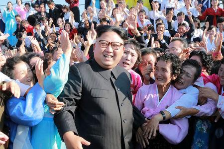 North Korean leader Kim Jong Un meets supporters in this undated photo released by North Korea's Korean Central News Agency